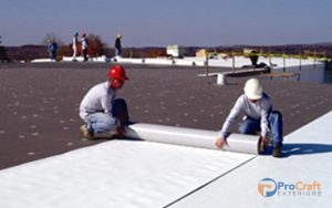 Roofer Completing PVC Roof Installations