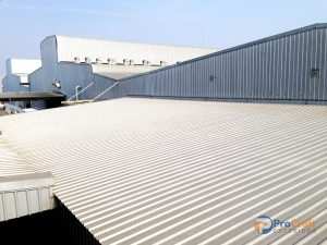 Industrial Building After a Commercial Corrugated Metal Roof Installation.